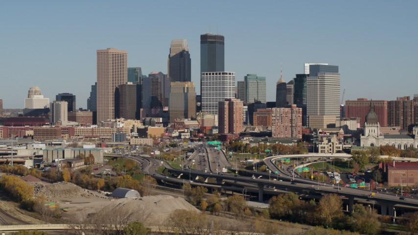 5.7K stock footage aerial video of flying by the city skyline behind the I-394 freeway, Downtown Minneapolis, Minnesota Aerial Stock Footage | DX0001_002183