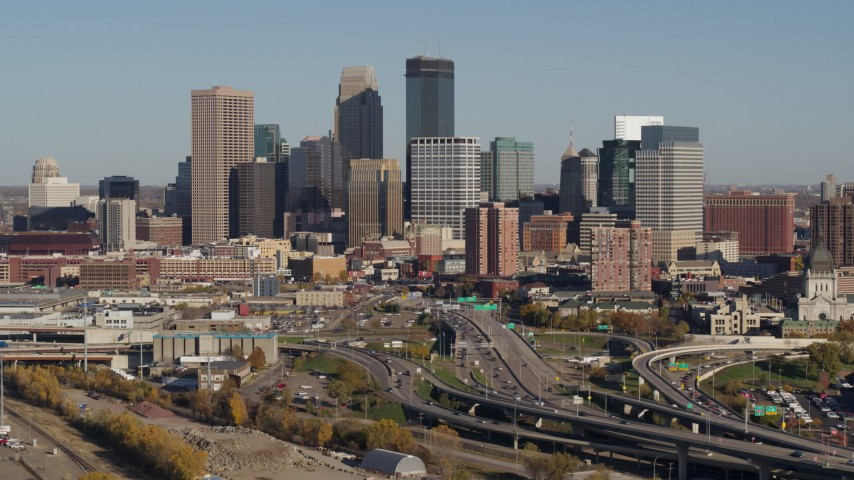 5.7K stock footage aerial video of a reverse view of the city skyline behind the I-394 freeway, Downtown Minneapolis, Minnesota Aerial Stock Footage | DX0001_002185