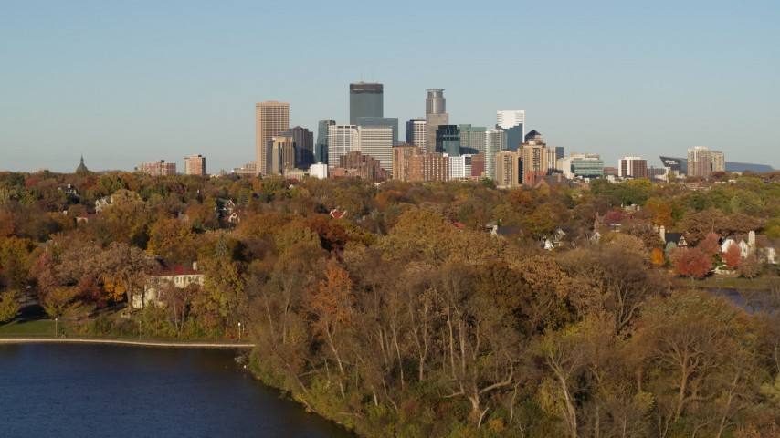 5.7K stock footage aerial video ascend from lake to wide view of the city's skyline, Downtown Minneapolis, Minnesota Aerial Stock Footage | DX0001_002194