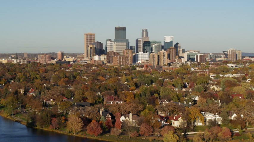 5.7K stock footage aerial video a wide view of the city's skyline seen from homes by the lake, Downtown Minneapolis, Minnesota Aerial Stock Footage | DX0001_002195