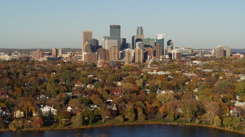 5.7K stock footage aerial video a wide view of the city's skyline seen from houses by the lake, Downtown Minneapolis, Minnesota Aerial Stock Footage | DX0001_002196