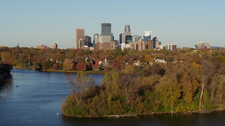 5.7K stock footage aerial video a view of the city's skyline seen from Lake of the Isles, Downtown Minneapolis, Minnesota Aerial Stock Footage | DX0001_002197