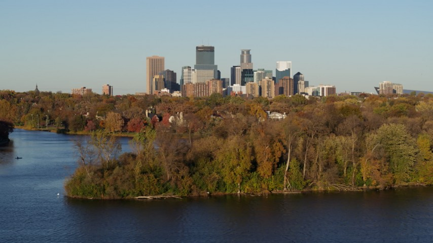 5.7K stock footage aerial video of the downtown skyline seen from the Lake of the Isles, Downtown Minneapolis, Minnesota Aerial Stock Footage | DX0001_002200