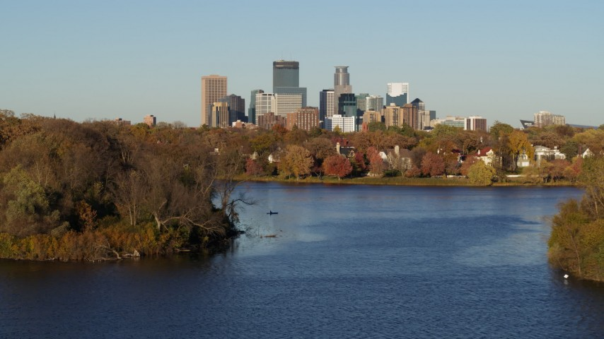 5.7K stock footage aerial video of the downtown skyline seen from homes by Lake of the Isles, Downtown Minneapolis, Minnesota Aerial Stock Footage | DX0001_002201