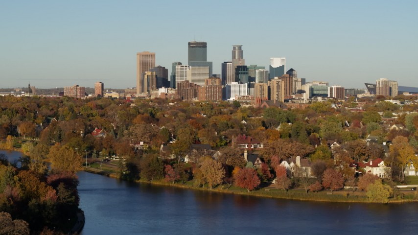 5.7K stock footage aerial video of the downtown skyline seen from waterfront homes by Lake of the Isles, Downtown Minneapolis, Minnesota Aerial Stock Footage | DX0001_002202