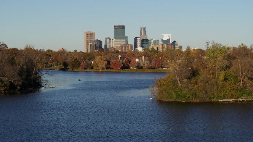 5.7K stock footage aerial video of the downtown skyline seen from Lake of the Isles, Downtown Minneapolis, Minnesota Aerial Stock Footage | DX0001_002203
