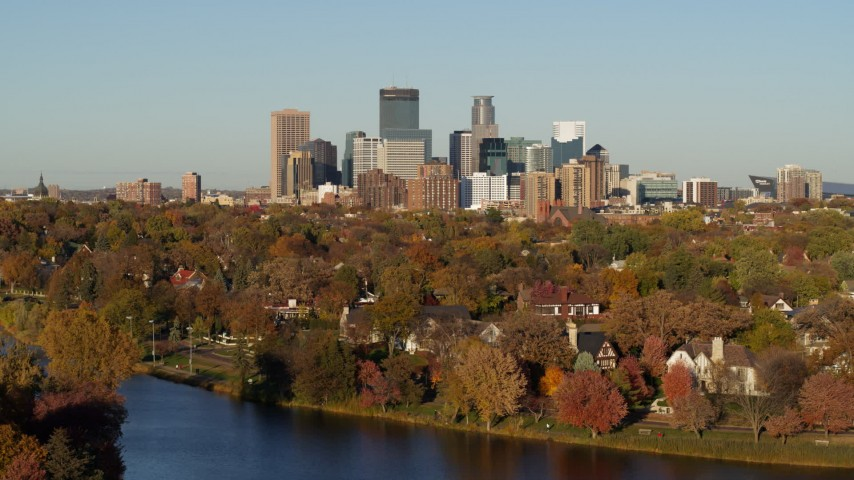 5.7K stock footage aerial video of the city skyline, seen from lakeside homes, Downtown Minneapolis, Minnesota Aerial Stock Footage | DX0001_002205