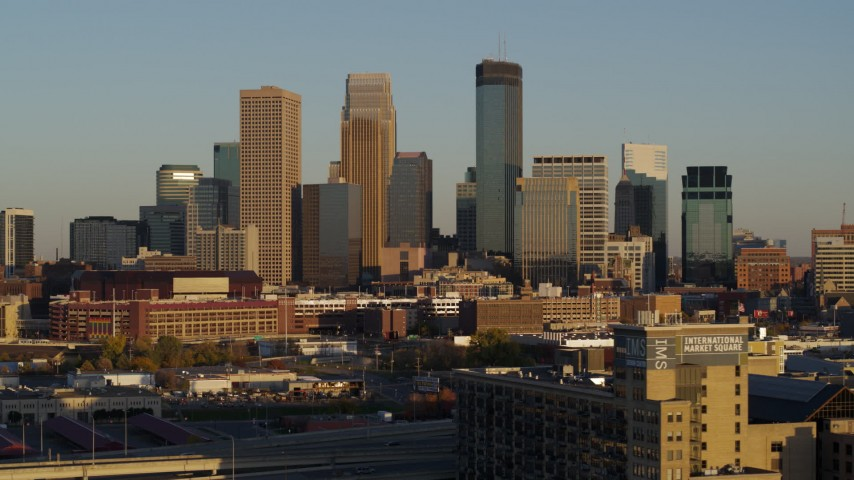 5.7K stock footage aerial video of flying by the city's downtown skyline at sunset in Downtown Minneapolis, Minnesota Aerial Stock Footage | DX0001_002214