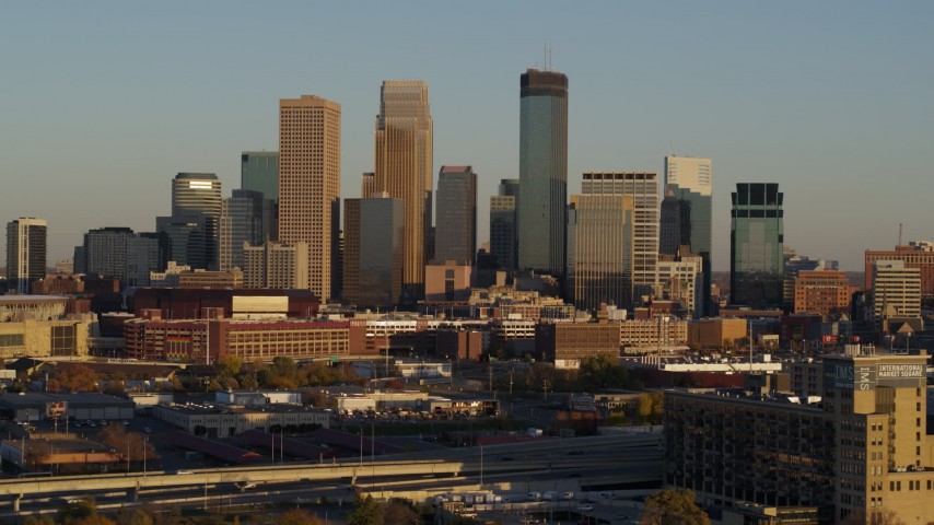 5.7K stock footage aerial video of approaching the city's downtown skyline at sunset in Downtown Minneapolis, Minnesota Aerial Stock Footage | DX0001_002216