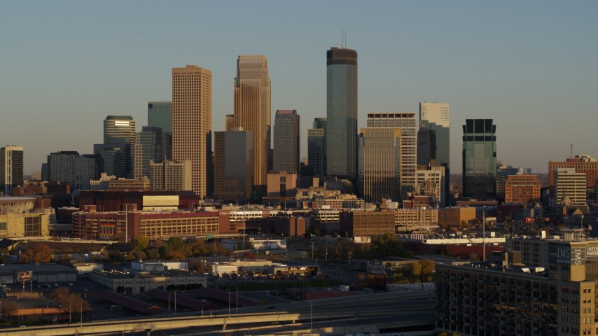 5.7K stock footage aerial video of ascending by the city's downtown skyline at sunset in Downtown Minneapolis, Minnesota Aerial Stock Footage | DX0001_002219