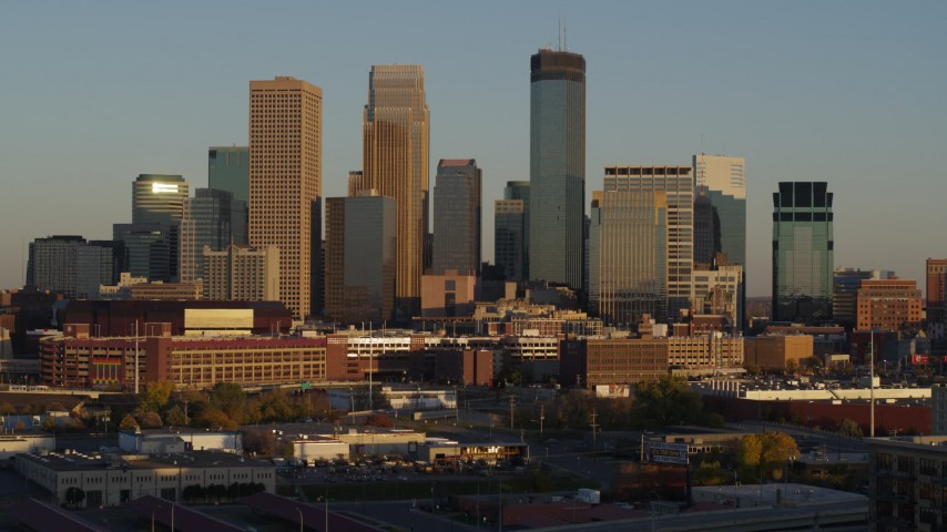 5.7K stock footage aerial video of descending by the city's downtown skyline at sunset in Downtown Minneapolis, Minnesota Aerial Stock Footage | DX0001_002220