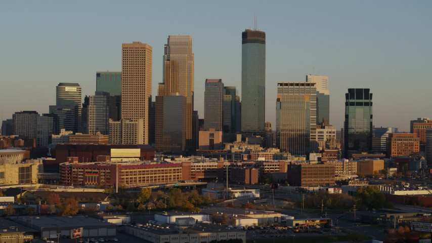 5.7K stock footage aerial video ascend and flyby the city's downtown skyline at sunset in Downtown Minneapolis, Minnesota Aerial Stock Footage | DX0001_002221