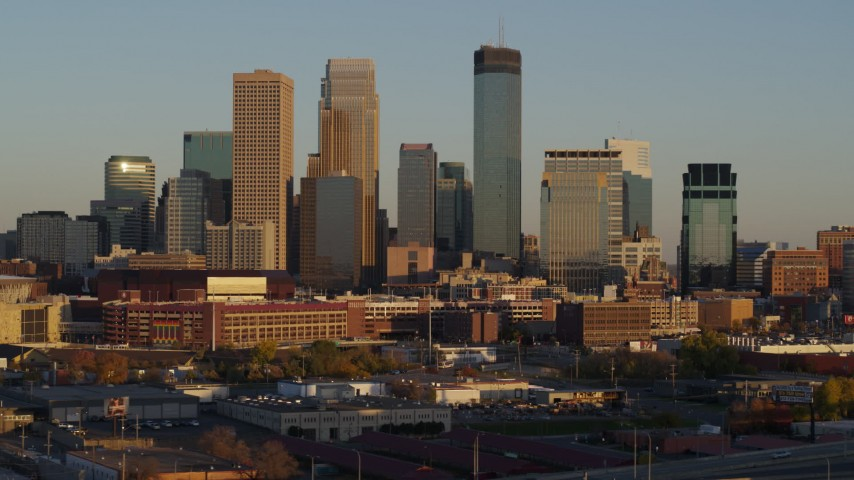 5.7K stock footage aerial video descend and flyby the city's downtown skyline at sunset in Downtown Minneapolis, Minnesota Aerial Stock Footage | DX0001_002222