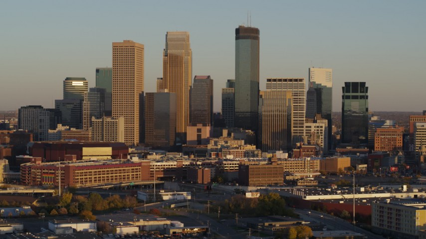 5.7K stock footage aerial video of passing the city's downtown skyline at sunset in Downtown Minneapolis, Minnesota Aerial Stock Footage | DX0001_002225