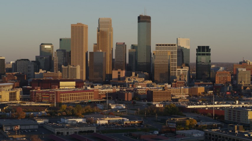 5.7K stock footage aerial video of slowly flying by the city's downtown skyline at sunset in Downtown Minneapolis, Minnesota Aerial Stock Footage | DX0001_002227