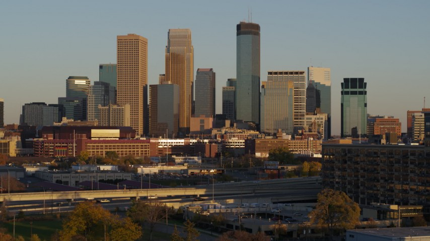 5.7K stock footage aerial video of the city's downtown skyline at sunset, seen during descent in Downtown Minneapolis, Minnesota Aerial Stock Footage | DX0001_002228