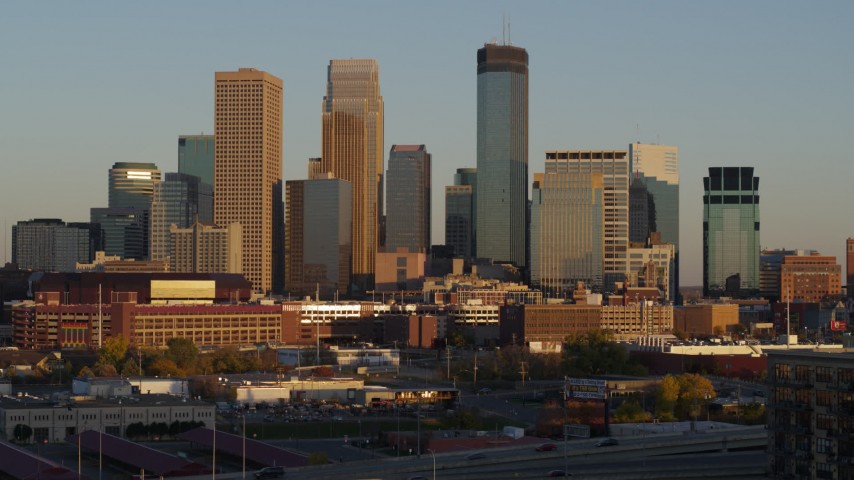 5.7K stock footage aerial video ascend and approach the city's downtown skyline at sunset, Downtown Minneapolis, Minnesota Aerial Stock Footage | DX0001_002229