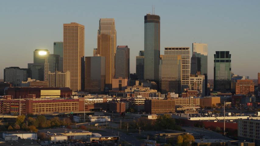 5.7K stock footage aerial video ascend to flyby the city's downtown skyline at sunset, Downtown Minneapolis, Minnesota Aerial Stock Footage | DX0001_002230