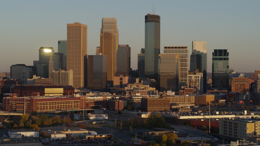 5.7K stock footage aerial video fly away from the city's skyline at sunset, Downtown Minneapolis, Minnesota Aerial Stock Footage | DX0001_002231