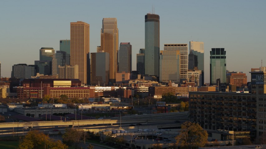 5.7K stock footage aerial video the city's skyline at sunset while descending, Downtown Minneapolis, Minnesota Aerial Stock Footage | DX0001_002232