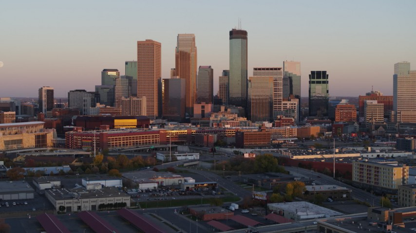 5.7K stock footage aerial video stationary view of the city's skyline at sunset, Downtown Minneapolis, Minnesota Aerial Stock Footage | DX0001_002234