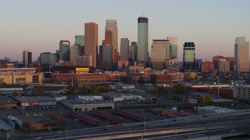 5.7K stock footage aerial video of the city's skyline at sunset, seen during descent, Downtown Minneapolis, Minnesota Aerial Stock Footage | DX0001_002235