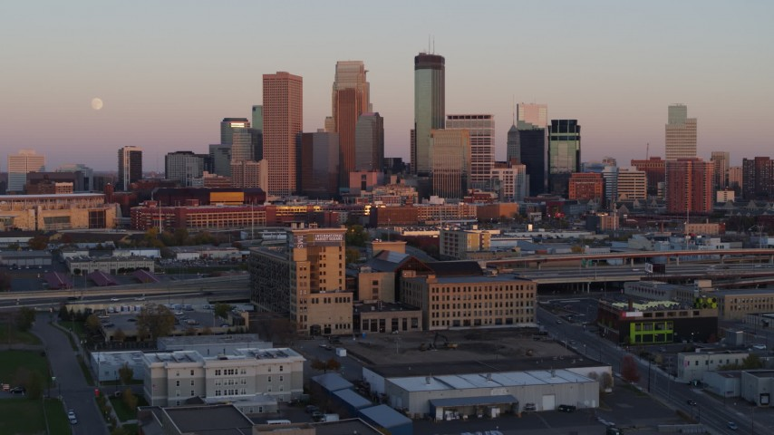 5.7K stock footage aerial video of the city's skyline and moon at sunset, seen from marketplace, Downtown Minneapolis, Minnesota Aerial Stock Footage | DX0001_002238