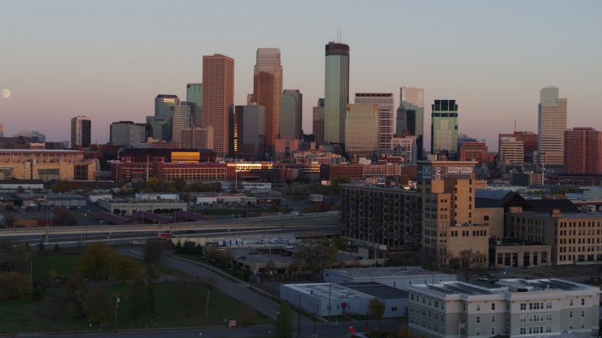 5.7K stock footage aerial video the city's skyline and the moon at sunset, seen from marketplace, Downtown Minneapolis, Minnesota Aerial Stock Footage | DX0001_002239