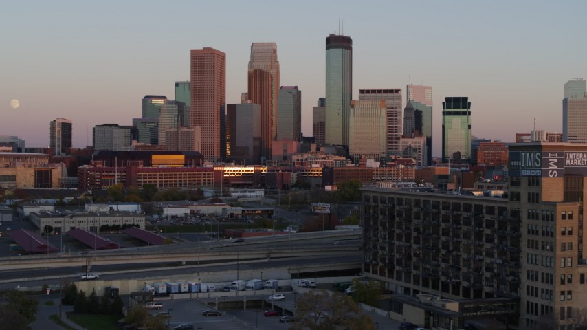 5.7K stock footage aerial video flyby city's skyline at sunset, seen from marketplace, Downtown Minneapolis, Minnesota Aerial Stock Footage | DX0001_002240
