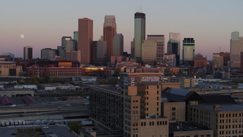 5.7K stock footage aerial video passing city's skyline at sunset, seen from marketplace, Downtown Minneapolis, Minnesota Aerial Stock Footage | DX0001_002241