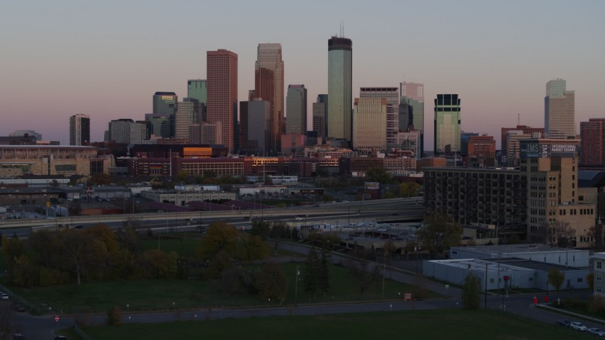 5.7K stock footage aerial video approach city's skyline at sunset from park, Downtown Minneapolis, Minnesota Aerial Stock Footage | DX0001_002243