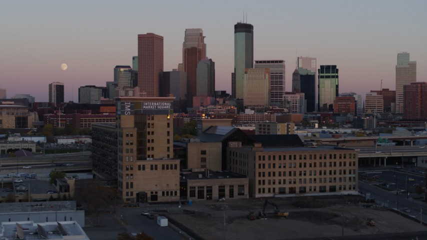 5.7K stock footage aerial video the city's skyline at sunset seen from marketplace, Downtown Minneapolis, Minnesota Aerial Stock Footage | DX0001_002244
