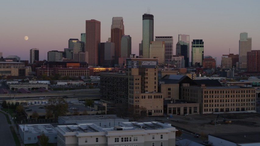 5.7K stock footage aerial video the city's downtown skyline at sunset seen from marketplace, Downtown Minneapolis, Minnesota Aerial Stock Footage | DX0001_002245