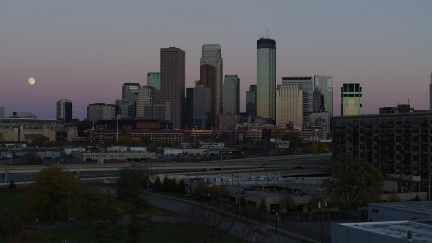 5.7K stock footage aerial video ascend from park for view of the city's downtown skyline at twilight, Downtown Minneapolis, Minnesota Aerial Stock Footage | DX0001_002246