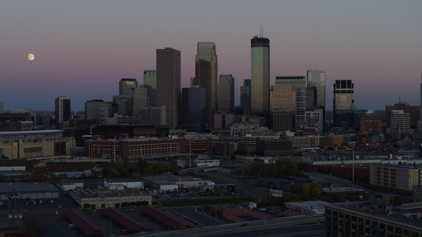 5.7K stock footage aerial video ascend for view of the city's downtown skyline at twilight, Downtown Minneapolis, Minnesota Aerial Stock Footage | DX0001_002247