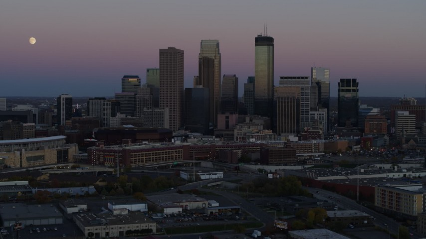5.7K stock footage aerial video a stationary view of the city's downtown skyline at twilight, Downtown Minneapolis, Minnesota Aerial Stock Footage | DX0001_002248