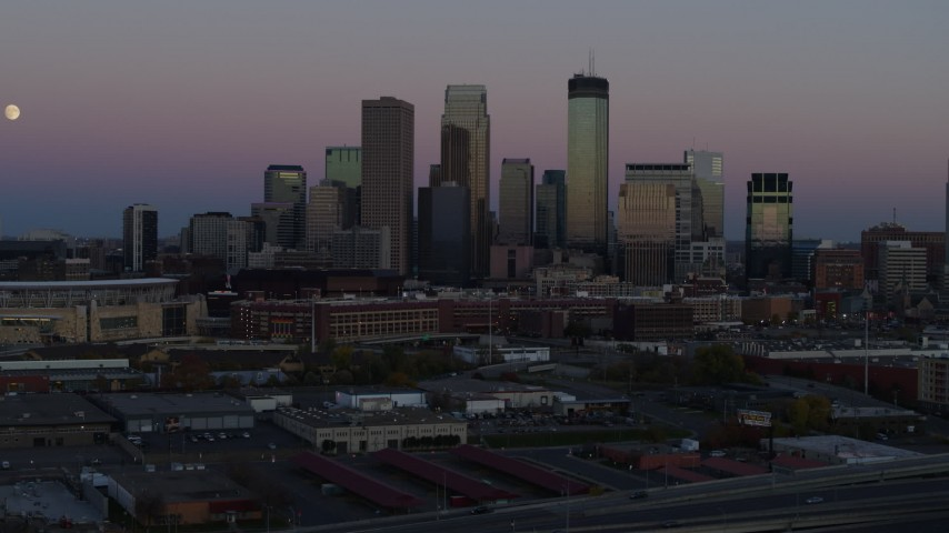 5.7K stock footage aerial video of the city's downtown skyline at twilight during descent, Downtown Minneapolis, Minnesota Aerial Stock Footage | DX0001_002249