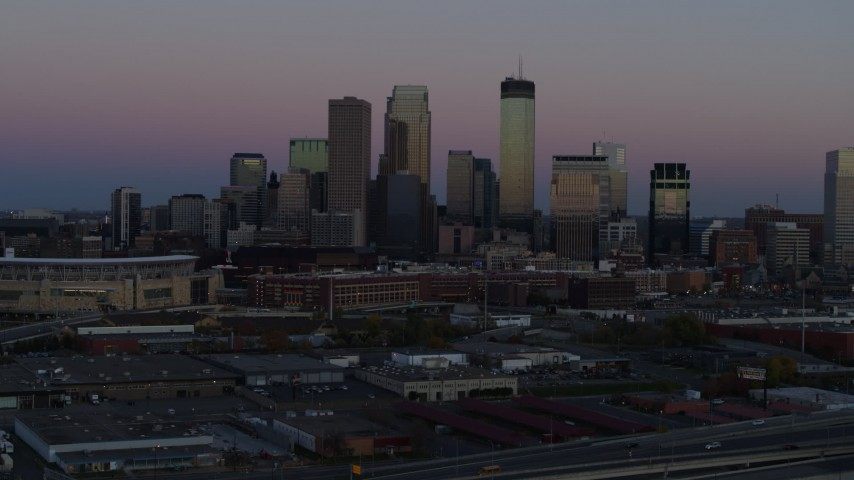 5.7K stock footage aerial video of the city's downtown skyline at twilight during ascent, Downtown Minneapolis, Minnesota Aerial Stock Footage | DX0001_002250