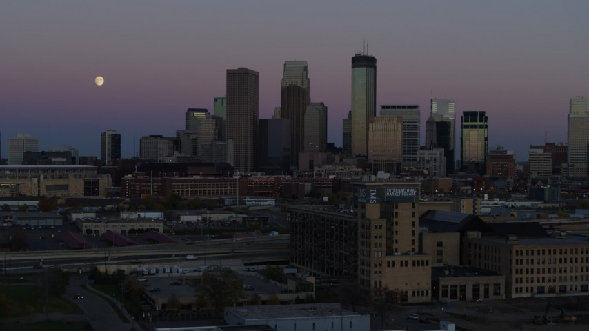 5.7K stock footage aerial video passing by the city's downtown skyline at twilight, seen from market, Downtown Minneapolis, Minnesota Aerial Stock Footage | DX0001_002253
