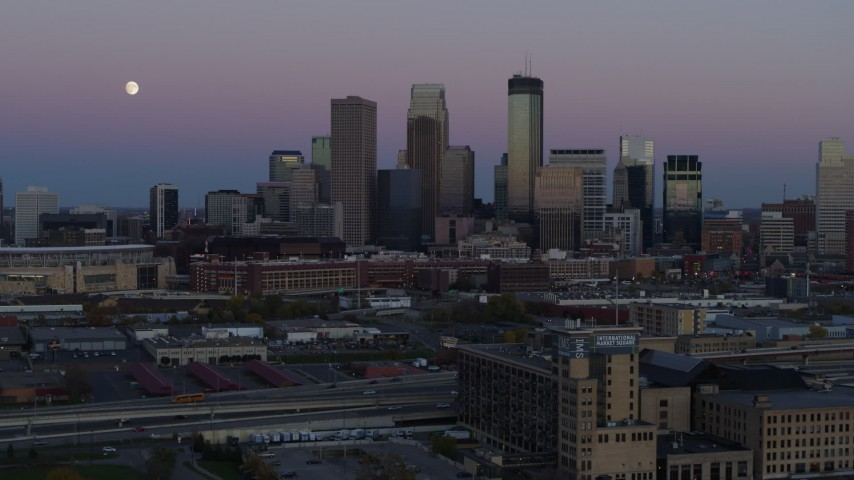 5.7K stock footage aerial video descend with market near the city's downtown skyline at twilight, Downtown Minneapolis, Minnesota Aerial Stock Footage | DX0001_002254
