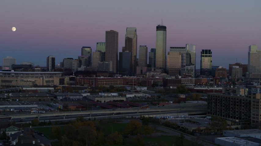 5.7K stock footage aerial video of the moon in the sky near the city's downtown skyline at twilight, Downtown Minneapolis, Minnesota Aerial Stock Footage | DX0001_002255
