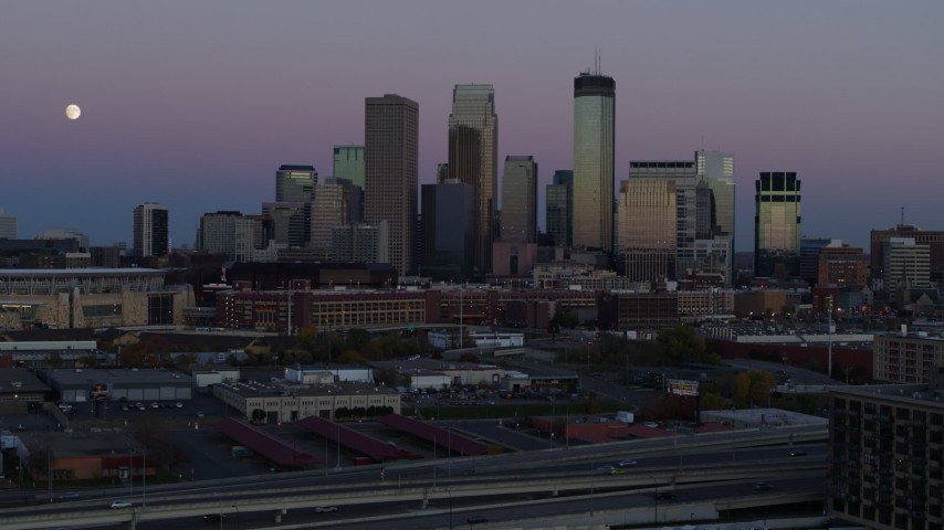 5.7K stock footage aerial video of the moon near the city's downtown skyline at twilight, Downtown Minneapolis, Minnesota Aerial Stock Footage | DX0001_002256