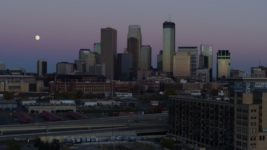5.7K stock footage aerial video of the moon near the city's downtown skyline at twilight, reveal market, Downtown Minneapolis, Minnesota Aerial Stock Footage | DX0001_002257