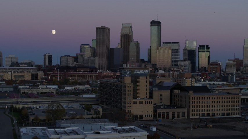 5.7K stock footage aerial video flyby market with the moon near the city's downtown skyline at twilight, Downtown Minneapolis, Minnesota Aerial Stock Footage | DX0001_002258
