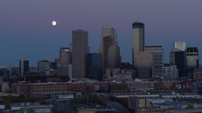5.7K stock footage aerial video ascend with view of moon near the city's downtown skyline at twilight, Downtown Minneapolis, Minnesota Aerial Stock Footage | DX0001_002259