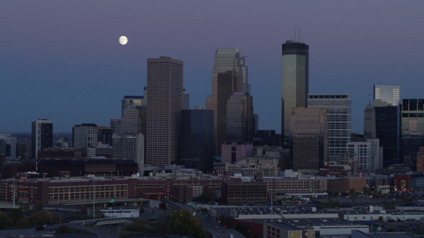 5.7K stock footage aerial video of moon above the city's downtown skyline at twilight, Downtown Minneapolis, Minnesota Aerial Stock Footage | DX0001_002260
