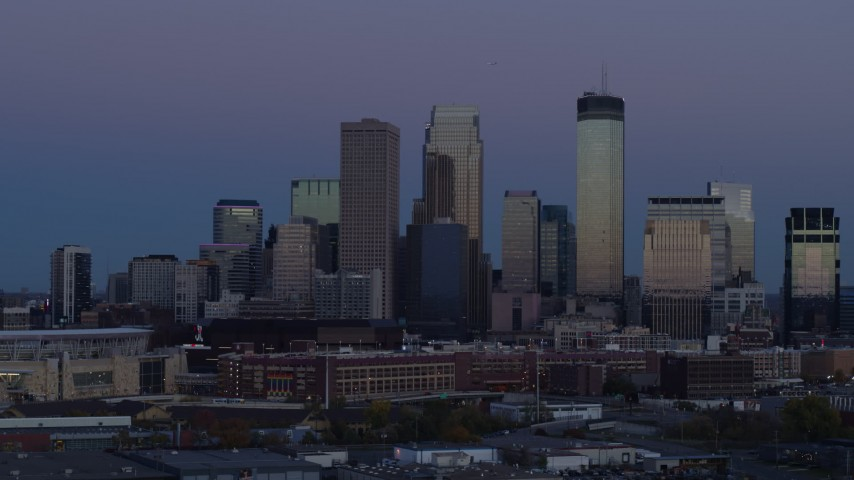 5.7K stock footage aerial video of flying by the city's skyline before ascent at twilight, Downtown Minneapolis, Minnesota Aerial Stock Footage | DX0001_002261
