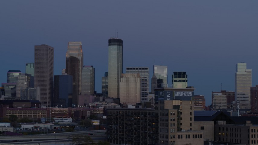 5.7K stock footage aerial video a view of skyscrapers in city skyline at twilight, Downtown Minneapolis, Minnesota Aerial Stock Footage | DX0001_002267