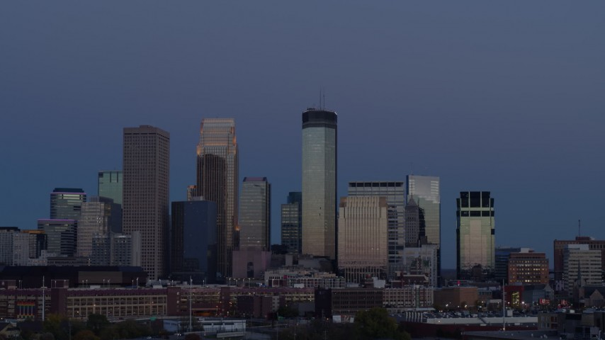 5.7K stock footage aerial video a view of skyscrapers in city skyline at twilight during ascent, Downtown Minneapolis, Minnesota Aerial Stock Footage | DX0001_002268