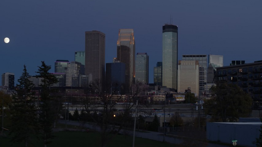 5.7K stock footage aerial video a reverse view of skyscrapers in city skyline at twilight, Downtown Minneapolis, Minnesota Aerial Stock Footage | DX0001_002270